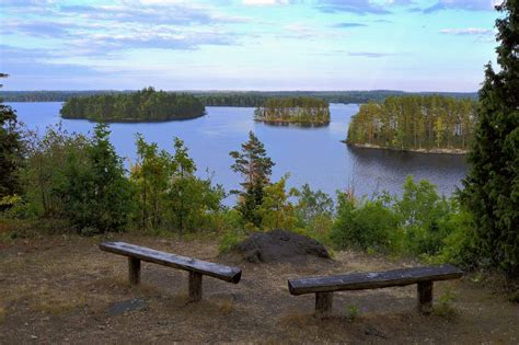 Benches Overlooking Body Of Water At Daytime · Free Stock